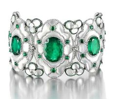 Bracelet set with 5 oval shaped emeralds totaling 19.35 cts surrounded by diamonds and mother of pearl marquetry. Set in 18K white gold. Bogh-Art