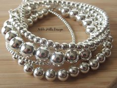 Our new website - https://nikkihillsdesign.com is now live. These beautiful sterling silver bead bracelets for women, feature shiny beads in the size of your choice, so that your beaded bracelet will be the perfect size for your frame. Minimal and timeless. An everyday bracelet. Available with 2mm, 3mm, 4mm and 5mm sterling silver beads. Choose to buy individual sterling bracelets or buy a stack bracelet set and wear them layered in different sizes for a modern stylish look. ----...