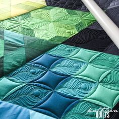 Great quilting pattern on quilt top made with large squares.