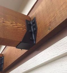 Image result for how to join wood beams and joists with metal bracket
