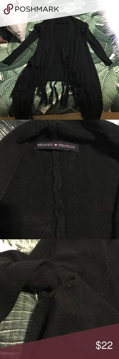 Brandy Melville fringe cardigan Used, has some lint all over (see pics) probably can be taken off with a lint roller. I used this maybe 5 times and washed once. Color is still very black. Please note this is used. One size but fits up to size L Brandy Melville Sweaters Cardigans
