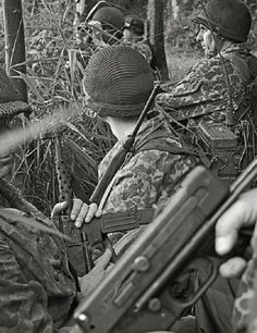 French Paratroops in Indochina circa 1953 ready their Mat 49 sub machine guns for a assault on Viet Minh guerrillas.
