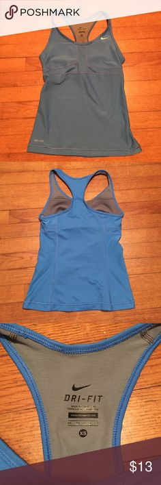 Nike Dri-Fit Running Tank Used but in very good condition. Built in shelf bra Nike Tops