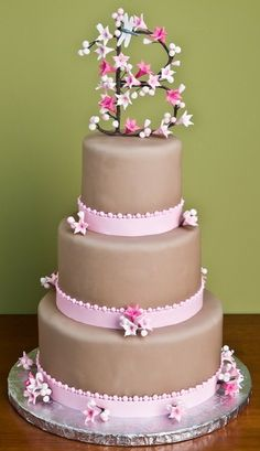 Three tier round brown fondant contemporary unique elegant wedding cake design with pink ribbons, sugar flowers and monogram toppper Brown Wedding Cakes, Fondant Wedding Cakes, Elegant Wedding Cakes, Wedding Cakes With Flowers, Wedding Cake Designs, Fondant Cakes, Cupcake Cakes, Wedding Ideas, Gorgeous Cakes