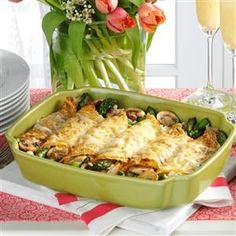 Chicken and Asparagus Crepes Recipe -The crepes used in this recipe come from my mom's special recipe, and can be made ahead of time, refrigerated to assemble the next day. Cooked rotisserie chicken is a real time-saver when making this savory brunch specialty. —Mary Sloan, Brighton, Michigan