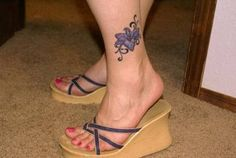 Larkspur Flower Tattoo, July birth flower.  Kind of what I am looking at getting with Julians name on my foot