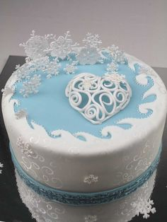 Winter Cake - love the snowflakes, and the silver swirls painted on the side.