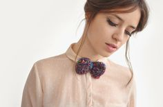 A good combination between knit bow tie with pink shirt