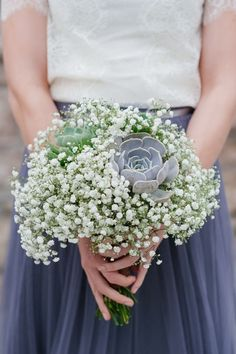 This baby's breath and succulent bouquet is simply beautiful.