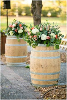 Wine barrel flower arrangements   Jeannine Marie Photography   see more at http://fabyoubliss.com