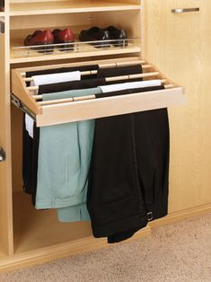 Trouser rack.  Looks nice but sideways rail not as practical as forward facing rails.