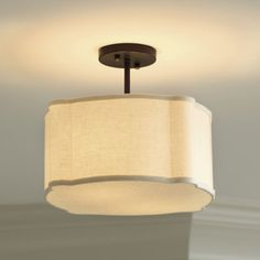 Now, I'm not a mom but I feel like this lighting would be perfect for a baby's room!  Love this light.  Ballard Designs Regan Semi-Flush Mount