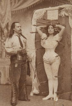 Knife thrower Signor Arcaris & sister Miss Rose Arcaris, 1900.  Job description: that would be knife thrower for him, risk taker for her, and together Entertainers and Performers