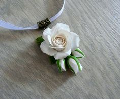 Delicate white rose of Fimo polymer clay. Flower size about 3cm. Specify the desired length of the tape, please.  This beautiful necklace is a great gift for your mom, sister, friend.  All my works are made with love. When buying them, you get a piece of my soul ... If you have any questions, please contact me. Best regards, Olga Samigulina.  Do not forget to visit my shop please, Im always glad to you. https://www.etsy.com/shop/OlgaSamigulina  vk.com/olgasamigulina_...