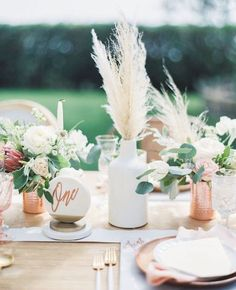 Pampas grass wedding centerpiece - pretty and modern wedding table decor idea with table number, florals, and pampas grass centerpiece. copper and white wedding.