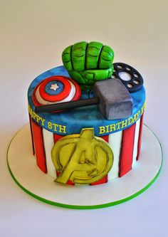 Avengers Cake. This one is perfect for an older kid. hopessweetcakes.com, Hope's Sweet Cakes: Avengers, Super Hero, and Frozen Ice Castle Cake