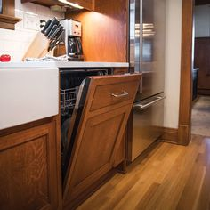 The Cabinet Wood Hides The Appliance While Maintaining The Historic Feel Of  The Home With A Panel Ready Dishwasher.