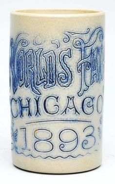 "Chicago World's Fair 1893 Stoneware Mug.  	      	                  Clean example overall with nice, bright, brilliant blues. Little to no wear noted.Condition (Excellent). Size 4 - 3/4"" T.    CORRECTION"