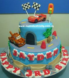 Cupcake Divinity.. Cupcakes fit for divines!: 2 Tier Lightning Mcqueen theme Fondant cake