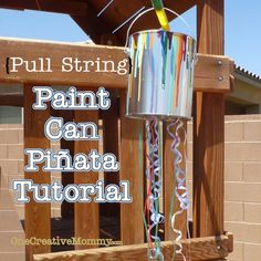 "Pull-String Paint Can Piñata Tutorial from OneCreativeMommy.com {Perfect for an art-themed birthday party.  Every kid gets to ""break"" the piñata at the same time.} #Piñata #birthday"