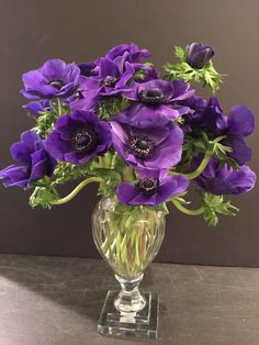Purple anemones flower arrangement. Via Greenwich Orchids