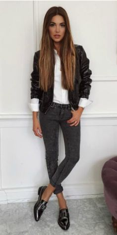 Negin Mirsalehi + patent black loafers + skinny grey jeans + rolled up + preppy + retro aesthetic + white button down + leather jacket.   Shoes: Aquatalia.