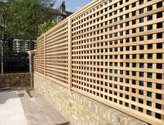 Iroko trellis with arched panel to finish