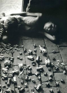 Sebastiao Salgado - This photo speaks to me because this child and his sibling, who is extremely skinny, is playing with his toys. He is still trying to have fun even though his situation is grim.
