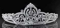 Belgian Scroll Tiara deisgned by Henry Coosemans in 1953. Set in platinum it holds 854 diamonds with 46.42 carats. The 8 carat center stone can be removed and worn as a ring, and the central element can be worn as a brooch. The Sociéte Générale, Belgium's national bank, gave it to the Grand Duchess Princess Joséphine-Charlotte of Belgium as a wedding gift.