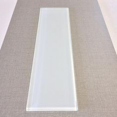 4x16 White Glass Subway Tile, some of the cheapest I have seen so far in this large format for $10.79 sq ft.