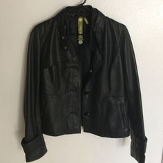 OBOSoia & Kyo Genuine Leather Designer Coat Brand new. Got as a gift from my mother but it fits me a little too snug for my liking. Button front closer, button cuffs and asymmetrical hem. Genuine leather ❤️ perfect condition. Soia & Kyo Jackets & Coats