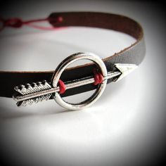 Silver Katniss - Hunger Games leather bracelet with red linen! $24 from JewelrybyMaeBee on Etsy.