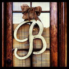 Wood initial door hangers with large burlap bows by OakOriginals, $38.00