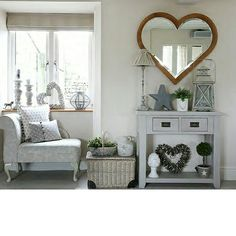 As featured in 25 beautiful homes Barker and Stonehouse mirror is the feature of this room.