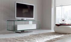 CRISTEL: Mesa TV acabada en cristal, con un cajetín de acero inoxidable y frente lacado en blanco brillo. Base y pie de acero.  Acabados: Blanco Brillo