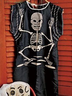 Beginning in the 1940s, manufacturers such as such as Ben Cooper Inc. began making costumes and selling them through Sears, JCPenney, Woolworths, etc. This skeleton outfit and hooded muslin mask is from the 1950s.