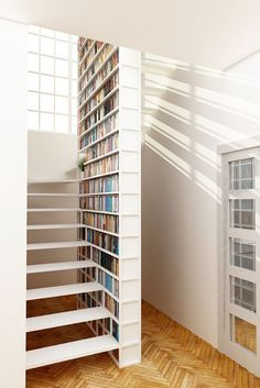 Unique steel staircase with integral library by Design+Weld