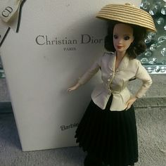 Rare christian Dior Barbie doll This is a brand new Dior Barbie doll never used or played with the box has 2 or 3 stains that are hard to see but I bought the doll that way Other