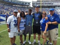 Davonte Robinson and Landon Young, both out of Lexington, pose with their families. Via CourierJournal.com