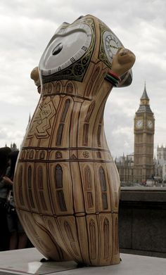 An Olympic mascot, painted in the likeness of Big Ben, is displayed across the River Thames from the actual Big Ben on Saturday, July 21, 2012, in London.