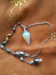 The Mermaid's Pendulum. Opalite point with Glass pearls, REAL Pearls and 2 chains. Very feminine.. $16.00, via Etsy.