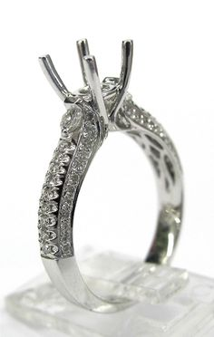 Ladies 14kt white gold semi mount. Mounted in ring are 68 brilliant round cut diamonds weighing a total of .47ct total weight. Mounting is made to take approximately 1.25ct round cut diamond in the center.