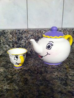 DIY Mrs. Potts and Chip craft for Beauty and the Beast family movie night. I took an old tea cup from one of my daughters tea sets and cut out a chip, spray painted with Valspar plastic primer then painted.  The tea pot was an Ocean State Job Lot $2 find that I painted over.