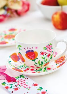 Use POSCA pens to bring your crockery to life! You will need: uni Posca Pens, 1MR Pink, Red, Violet, Green; 3M Orange, Bright yellow, Light Pink, Apple green Metallic green, pink, red White ceramics/china Cardstock, various colours Adhesives Transfer paper1 Wash china in warm soapy water and dry with a soft cloth. Transfer the illustrations onto the ceramic surface. For curved surfaces, rub a pencil over the lines on the transfer paper to fill any gaps.2 Begin with a few short lines/stems…