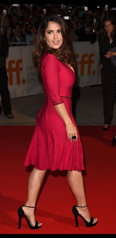 Salma Hayek sexy legs in a red dress and high heels on the red carpet