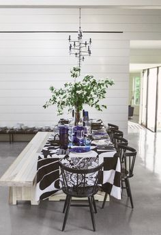 black and white dining room with layered patterned linens