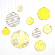 Create bright and easy wall art using fabric and embroidery hoops. Mix solids and patterns in different sizes for a unique, one-of-a-kind look.
