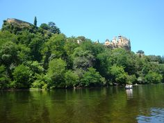 Canoe on the Dordogne & paddle past this majestic castle, Montfort.