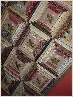 Log cabin quilt. Note the different way to set it up - the larger square in centre, and the lights and darks positioned this way look like a 'stepped' frame. Cool.: