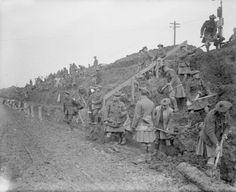 THE BATTLE OF THE SOMME, JULY-NOVEMBER 1916 12th (Labour) Battalion, the Black Watch (Royal Highland Regiment), broadening a road at Fricourt, outside the 48th (South Midland) Divisional Headquarters.